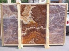 Supply polished slabs 0.8 cm in natural onyx ONYX RED E-14639. Detail image pictures